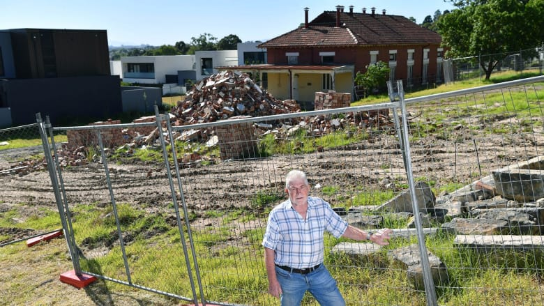 Former boss of the old                                           Kew insitution Max Jackson                                           amongst dilapidated heritage                                           buildings